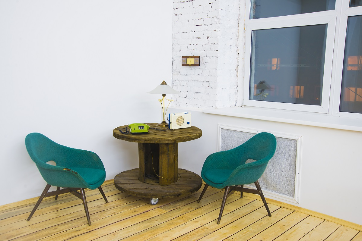 Two green chairs in house corner