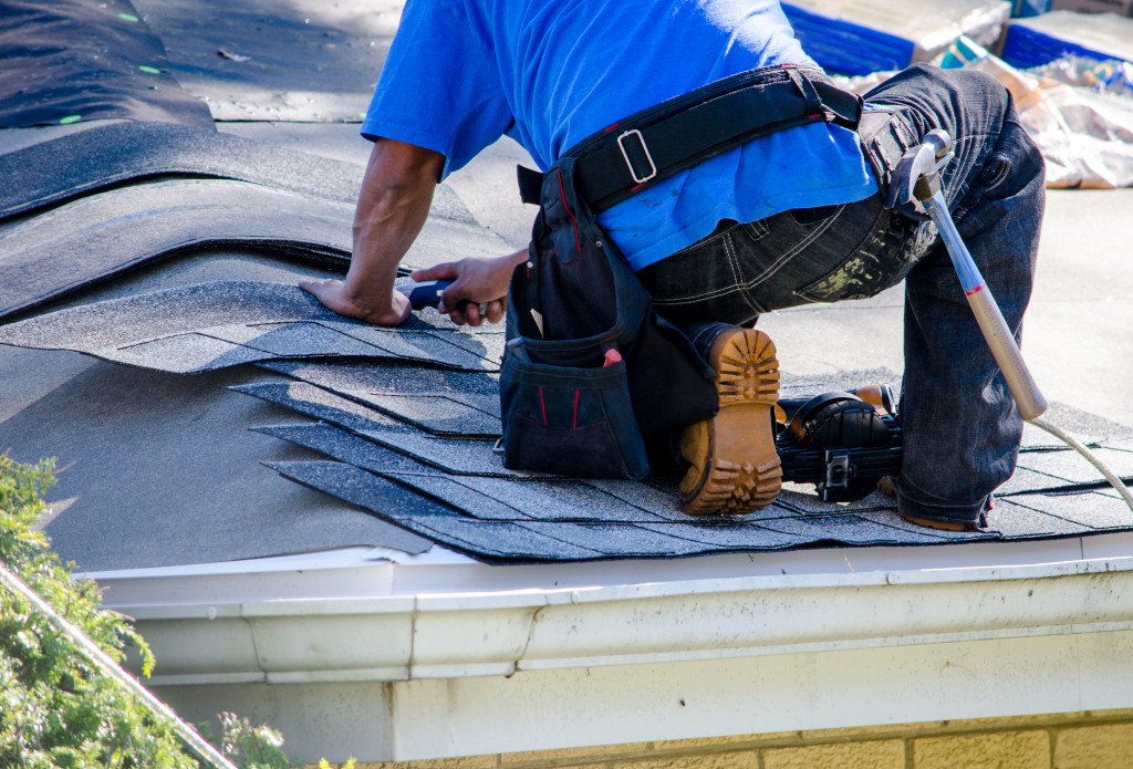 Roof being fixed