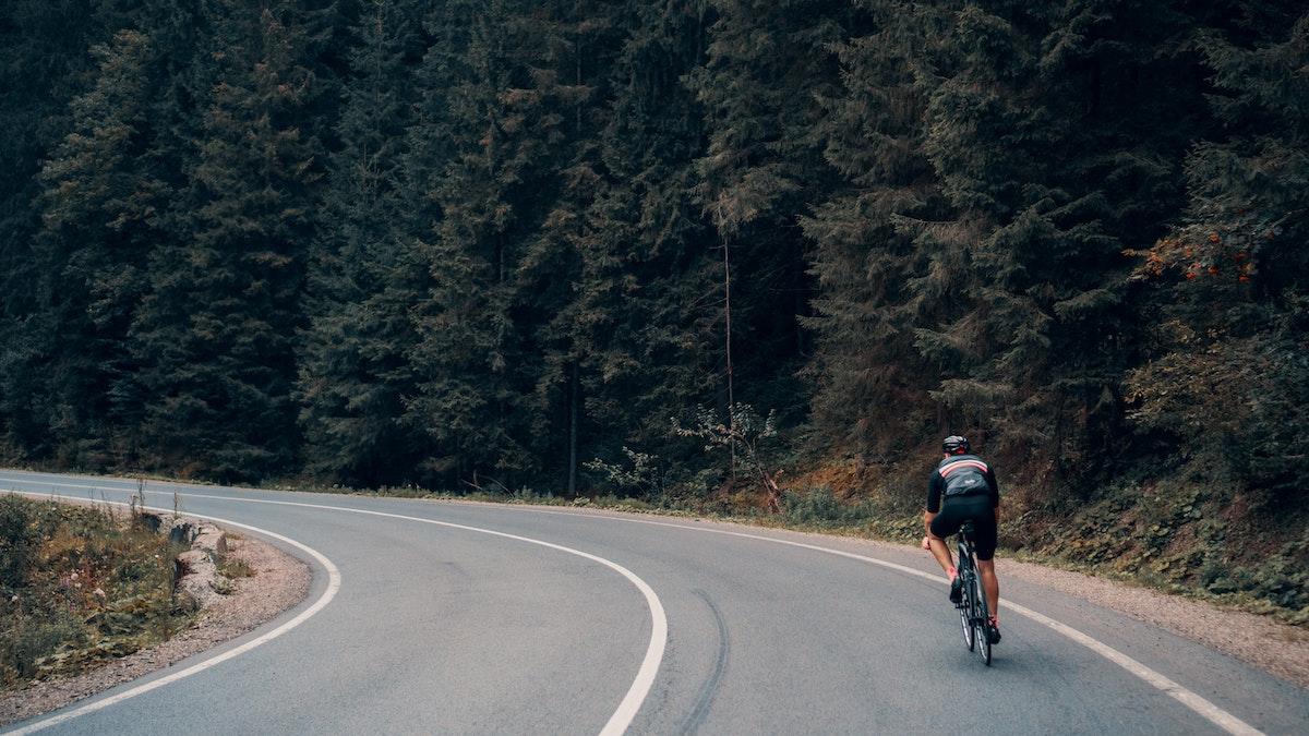 man biking along the open road