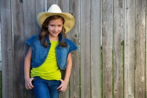 girl wearing cowboy outfit